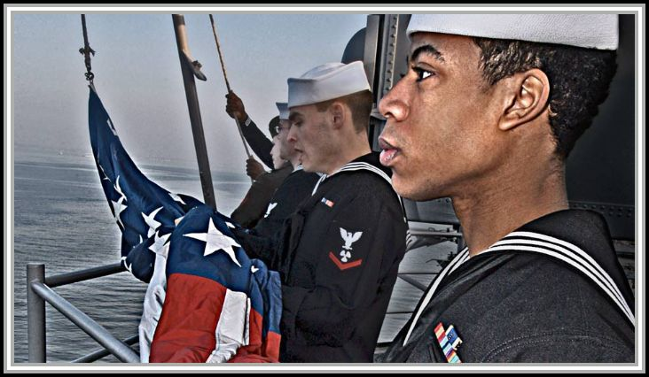 scan of image - Sailors prepare to raise the American Flag during morning colors.