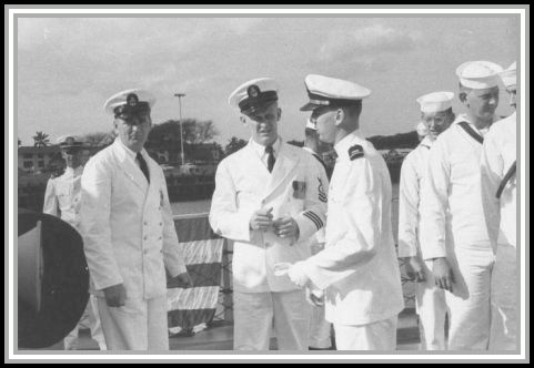 photograph of (L. to R.) Chief Electronics Technician Hopkins, Master Chief Shupzinski, and Jim Moon 01/1960.