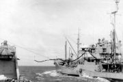 photograph showing ship receiving replenishment