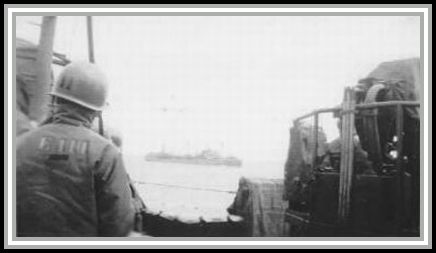 photograph showing SAVAGE escorting a tanker