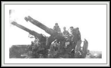 photograph showing manned 40 mm anti-aircraft guns (crewmembers unknown)