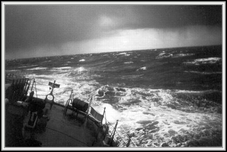 photograph of the DER-386 in a storm at sea